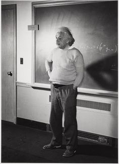"Einstein's favorite image of himself at his home in Princeton by Lucien Aigner, 1940.  Here's what he wrote to Aigner on the print (translation):  ""With the science you are busy; Losing your pants is so easy. The picture however is very pretty. With kind regards,  Yours truly. A. Einstein"""