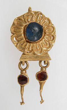Earring Date: 3rd century Culture: Pontic Medium: Gold, garnet, glass paste?