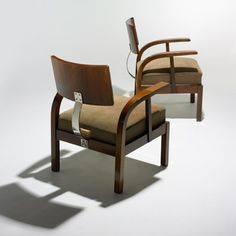Lot 230: Lajos Kozma. armchairs, pair. 1932, walnut, upholstery, nickel-plated steel, linoleum. 26 w x 30 d x 33½ h in. estimate: $15,000–20,000. Signed with red paper manufacturer's label to underside of each example: [JH] and stamped [Ellenorzes Mozeum Kiviteli Iparmuveszeti].
