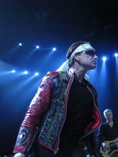 """U2 ~ Bono. His banda thing says """"COEXIST"""" with the C as a moon, the X as the star of David, and the T as a cross"""