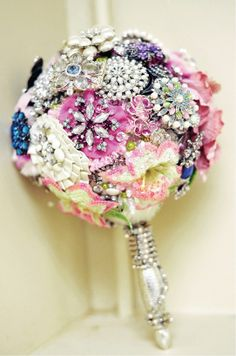 Vintage brooch bouquet . Made on an oasis ball with the beautiful bouquet holder, very pretty handle.