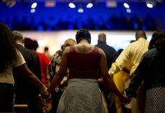 """Parishioners holds hands during a moment of prayer at a service at Southern Baptist Church Sunday, May 3, 2015, in Baltimore. A nearby senior center being built by the church was burned during the riots following Freddie Gray's funeral. Gov. Larry Hogan has called for a statewide """"Day Of Prayer And Peace"""" on Sunday after civil unrest rocked Baltimore. EQUALITY: The policies that wrecked Baltimore actually extend across 20 years- they are generational policies. Hateful policies that begun…"""
