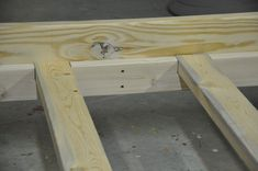 Bedrails made with 2x8s and 2x4s slotted for 2x4 support beams