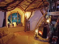 A cob-built hobbit house in Wales!! incorporates recycled building