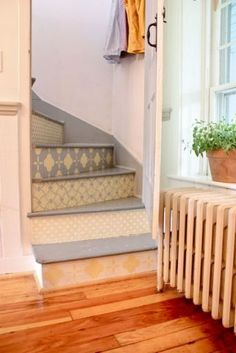 Gorgeous! Patterned stairs, wood floors, beautiful door, and window!