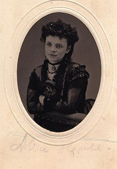 A sublimely clear Victorian tintype, circa 1875, of a stylishly attired young woman.