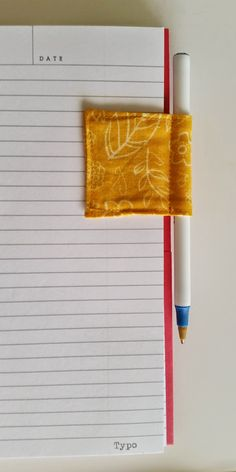 Magnetic Bookmark and Pen Holder - I might try crocheting the rectangles and going from there - looks easy enough - brilliant idea...