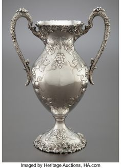 AN AMERICAN SILVER REPOUSSÉ TWO-HANDLED VASE . Circa 1900. | Lot #68228 | Heritage Auctions Perfume, Antique Silver, American, Crystals, Antiques, Circa, Glass, Decorations, Silver