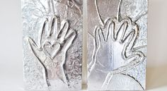 A creative way to capture kids' little handprints. Makes a lovely gift for Dads!
