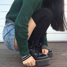 black and white striped long-sleeve shirt under dark green knit sweater ~ black leather belt ~ jean shorts ~ black socks ~ platform doc martens