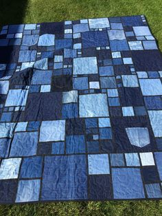 This is a homemade fun denim quilt with a cotton baton and machine long armed polar fleece checkered back. 75 X 53 This quilt is perfect for taking outdoors to a park or even the beach. Would be a great fire side snuggle blanket for beginning and end of the season camping trips. This quilt is very heavy Made in a smoke free, pet free home.