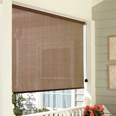 Roll Up Solar Shade-Window Shades / I think these may be perfect for the family room when the sun is shining in through the window.