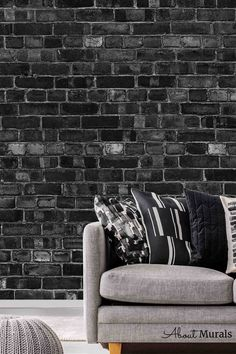 Black Brick Wallpaper is a photo mural of a realistic looking black brick wall. It looks stunning in a living room, bedroom, office or kitchen. The unique photographic process creates a high resolution image that captures all the texture in the brick wallpaper. It's easy to hang, so perfect for DIY enthusiasts! It's also removable when you're ready to redecorate. Black Brick Wallpaper, Faux Brick Walls, Photo Mural, Bedroom Office, It's Easy, Wall Murals, Black And Grey, Texture, Living Room