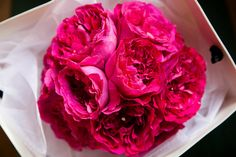 #Brides, brighten up your look with a hot pink bouquet. These lively rich magenta-pink #weddingroses provide the right amount of color that will pop next to a white #weddingdress. Add small diamonds to make this bouquet sparkle when seen in mood lighting, especially for evening weddings.  online @ www.parfumflowercompany.com