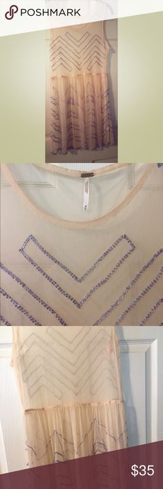 Free People Embellished Sheer Tunic Size M Super cute embellished sheer tunic. Light peachy color with purple/violet beadwork. Has only been worn once there are a few places missing beads but still in good shape! Can be worn several different ways! Free People Other
