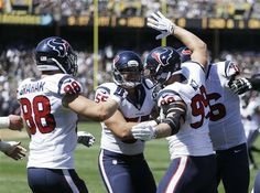 Houston Texans defensive end J.J. Watt, right, is greeted after scoring a touchdown by teammates Garrett Graham, left, and Chris Myers   (AP Photo/ Ben Margot)