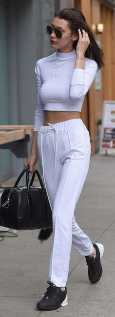 Bella Hadid: Sunglasses – Christian Dior Shirt and pants – Brash Sports (BRASHY) Purse – Givenchy