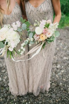 bridesmaids wearing taupe dresses with beads holding loose floral bouquets #bridesmaidsdresses
