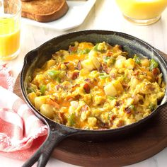 Country-Style Scrambled Eggs Recipe -I added a little color and flavor to ordinary scrambled eggs with some green pepper, onion and red potatoes. —Joyce Platfoot, Wapakoneta, Ohio