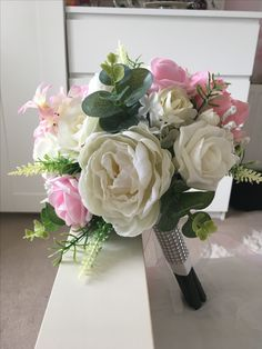 Pink, ivory, roses and peonies. One I made myself