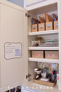Organized kitchen cabinet command center from Eleven Gables