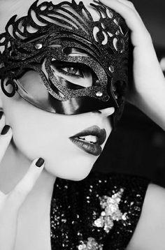 A black styled mask. MAISON kiss Kiss LONDON