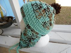 This hat is made with double strands of acrylic yarn that can be washed GENTLE cycle and hung to dry.  www.KaysKoolKrochet.Etsy.com
