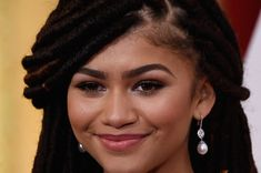 22 Celebrities Who Slayed The World With Their Locs