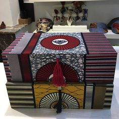 Two big boxes custom made for @ladyafricadfl (not for sale!). They fit in perfect  at the shop at #denneweg in #thehague Check out the store for its great selection of African fashion and accessories! Spice up those grey rainy days!!  Order your own #custommade boxes at @geckoboxes .  #africanfabric #customorder #storage #shoebox #cartonnage #cardboard #waxprint #africanprint #thisoneisnotforsale #handmade #vlisco #africanfashion #homedecoration