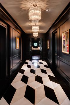 When designing a black and white hallway, don't be afraid to go bold with your tile designs.