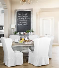 Kitchen Dining Area. love the slipcovered chairs, table & creative use of black chalkboard paint.