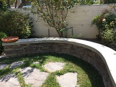 Serpentine Seating with concrete cap- Beavers Residence- Designed by Land Interactive