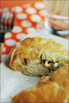 Cream cheese/ bacon/ onion stuffed chicken breasts wrapped in puff pastry.