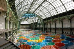 Buren's installation, named Excentrique(s), fills the entire nave of the Grand Palais