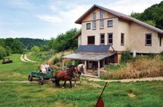 """Robert and Summer Schulz take their horse-drawn wagon out for a ride.  They write: """"We built our own straw/clay home and got off the grid. Now we're growing our own food and living our dreams!"""""""