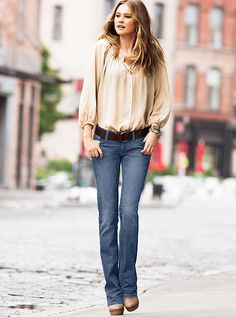 Bootcut jeans seen in today's fashion. They are still straight from hip to heel. Unlike a skinny jean, they're loose at the ankles.  3/8/16