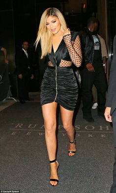 Legs eleven! Jenner showed off her long legs with her strappy heels and tight number