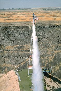 Daredevil Evel Knievel flies the Skycycle a rocket-propelled motorcycle, in an attempt to jump across the Snake River in Idaho in The stunt failed after his parachute malfunctioned and opened prematurely, thus halting his forward thrust. Back In The Day, 2 In, Robbie Knievel, Evil Kenevil, Snake River Canyon, Epic Fail Pictures, Le Far West, Daredevil, Latest Video