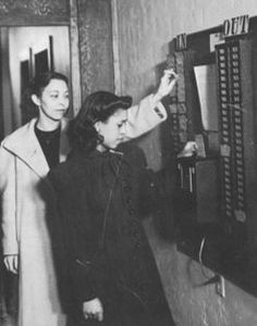 Women punch in for work at the Golden State Mutual Life Insurance Company Home Office located at 4261 (formerly 4111) S. Central Ave in Los Angeles, California.