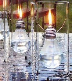 make this lantern from light bulbs and cut liquor bottles