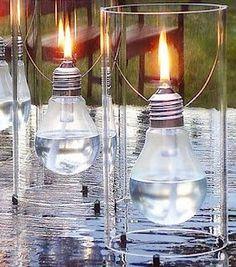 make this lantern from light bulbs and cut liquor bottles