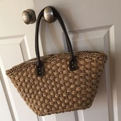 J.Crew Straw Bag Perfect for the pool or beach! Or just a fun summer purse! Excellent condition other than some minor wear on straps. J. Crew Bags