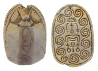 """Carved white limestone scarab, the Egyptian symbol of resurrection, the bottom with Egyptian symbols and swirling designs. Hole for wearability. 18th Dynasty.  Size: ½""""  Date: 1570-1342 BC"""
