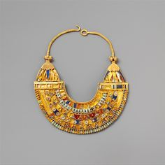 Miniature broad collar, 332-222 B.C., Egypt. Gold, carnelian, turquoise, lapis lazuli. The Metropolitan Museum of Art, New York. Harris Brisbane Dick Fund, 1949 (49.121.1). #gold #lapislazuli