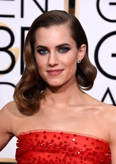 The Girls star looks ever so sultry with seriously smoky eyes, bold brows, andOld Hollywood waves styled into a faux bob.   - ELLE.com