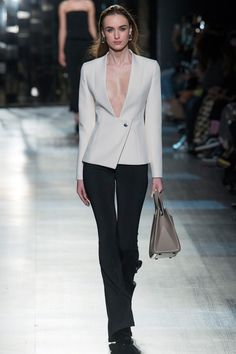 Slinky, sexy looks from a cocktail frock that bared both flank and haunch to the flowing monochromatic jumpsuit that opened the show, the Cushnie et Ochs fall 2017 Ready To Wear collection was sexy-at-all-costs clinging silhouettes for the ultimate sophisticated party girls.    Click through the