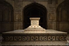 Tomb of the mughal emperor Jehangir. The interior of the mausoleum is an elevated sarcophagus of white marble, the sides of which are wrought with flowers of mosaic in the same elegant style as the tombs in the Taj Mahal at Agra, India. On two sides of the sarcophagus the ninety-nine attributes of God are inlaid in black. Intricate marble 'jalis' admit light in various patterns.   Photo © intricateworks.com