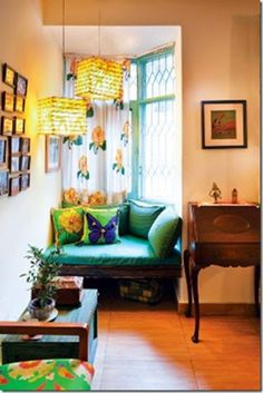 traditional indian homes wooden swings and tapestry - Homes Interior Designs