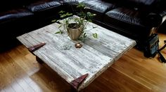 Metal detailing hinges on a wooden door coffee table