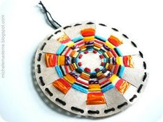 michele made me: Amidst The Rain A Woven Sun. A new spin on paper plate weaving.  Love it.